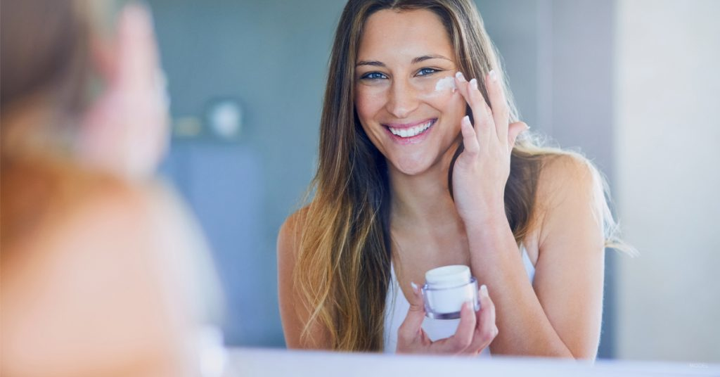 Smiling woman loves her new skin care routine.