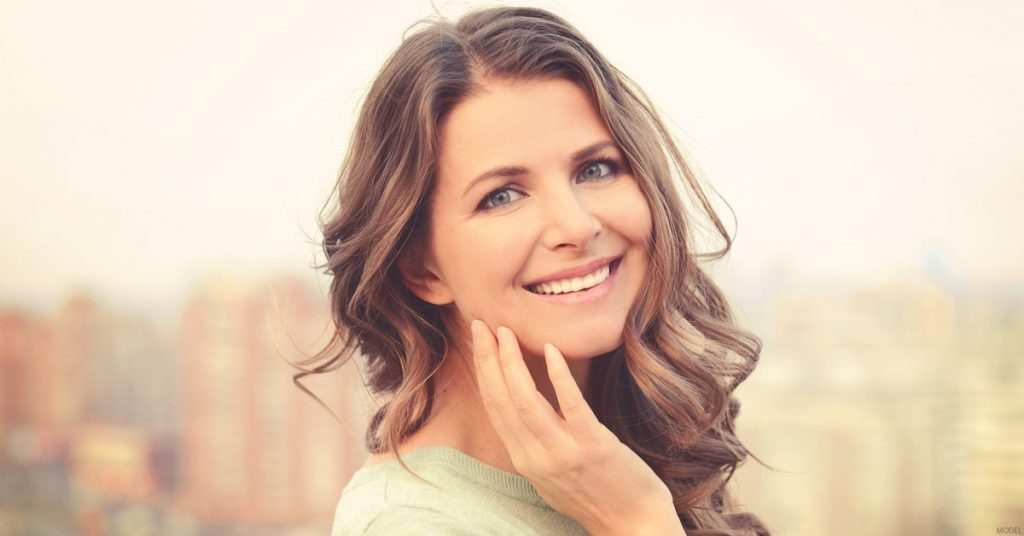 A women feeling wonderful after her JUVÉDERM® treatment in Ontario.