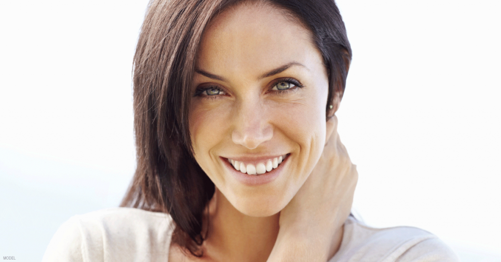 Head shot of attractive, smiling woman with short, brown hair